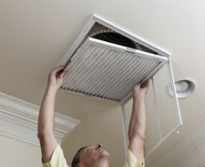 Man fixing air conditioning filter